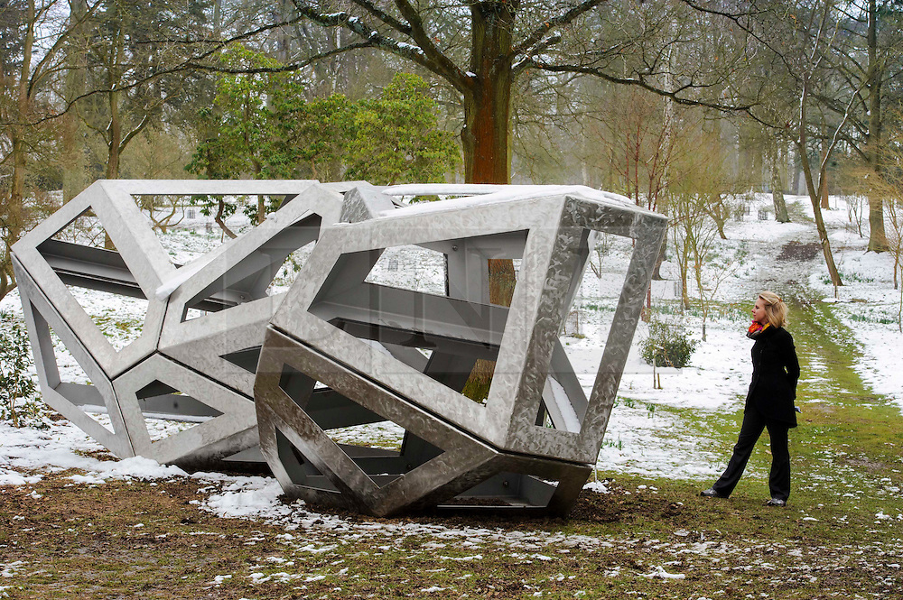 © Licensed to London News Pictures. 27/03/2013 Hatfield UK. A visitor to Hatfield House, Herts admires Richard Deacon's 'Congregate'. The sculpture is part of a Royal Academy exhibition that showcases six of their sculptors.This is the first time that the Royal Academy of Arts has collaborated with another organisation to curate an exhibition of Royal Academicians' sculpture outside the Royal Academy..Photo credit : Simon Jacobs/LNP