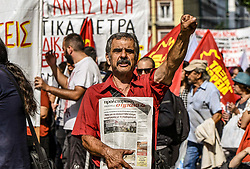 A demonstrator shout slogans during a demonstration marking a 24-hour general strike in Athens, Greece, 02 October 2019.<br /> <br /> Pictured: <br /> Dimitris Lampropoulos  | EEm date