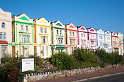 Colourfully painted guesthouses and hotels on the Esplanade, Paignton, Devon, England