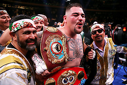 Andy Ruiz Jr (centre) celebrates the win in the WBA, IBF, WBO and IBO Heavyweight World Championships title fight at Anthony Joshua at Madison Square Garden, New York.