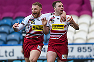 TRY. Liam Marshall (2) of Wigan Warriors celebrates his try with Jackson Hastings (31) of Wigan Warriors during the Betfred Super League match between Huddersfield Giants and Wigan Warriors at the John Smiths Stadium, Huddersfield, England on 1 March 2020.