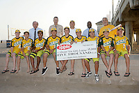 26 September 2011: 2011 Little League Baseball World Series Championship team portrait northside of the Huntington Beach Pier at sunset in Southern California.  Ocean View team WEST beat Hamamtsu City, Japan, 2-1, to become the seventh team from California to win the title on August 28, 2011 in South Williamsport, PA.  Ralphs Grocery Store sponsor photo.
