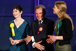 © Licensed to London News Pictures. 07/05/2016. London, UK. London Mayoral candidates Lib Dem's CAROLINE PIDGEON, UKIP's PETER WHITTLE and Green Party's SIAN BERRY reacting to announcement of the election results at City Hall in London on Saturday, 7 May 2016. Labour MP Sadiq Khan has declared his victory and accused his Conservative counterpart, Zac Goldsmith MP of using underhand tactics during the campaign. Photo credit: Tolga Akmen/LNP