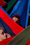 Lounging in hammocks in the Park, Glastonbury run by Emily Eavis (daughter of Michael Eavis) <br /> Glastonbury is the world's biggest greenfield festival with nearly 200,000  visiters camping in the dairy farm of Michael Evis in Somerset, UK.<br /> The first festival was in 1970 and was influenced by hippie ethics and the free festival movement. The festival retains vestiges of this tradition such as the Green Fields area which includes the Green Futures and Healing Field.