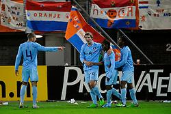 17-11-2009 VOETBAL: JONG ORANJE - JONG SPANJE: ROTTERDAM<br /> Nederland wint met 2-1 van Spanje / Luuk de Jong feliciteert Vurnon Anita die de assist voor de 1-0 gaf. Rechts Georginio Wijnaldum<br /> ©2009-WWW.FOTOHOOGENDOORN.NL