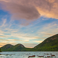 Maine panorama photography prints of Jordan Pond in the early fall as seen shortly before sunset. This beautiful pond is in the heart of Acadia National Park on Mount Desert Island and one of the top photo hot spots for waterscape photography. The shore line and rocks in the foreground provide interesting compositional elements while leading the viewer towards the South and North Bubbles in the back of the frame. <br /> <br /> Jordan Pond and the Bubbles panorama photos are available as museum quality photography prints, canvas prints, acrylic prints, wood or metal prints. Prints may be framed and matted to the individual liking and room decor needs:<br /> <br /> http://juergen-roth.pixels.com/featured/jordan-pond-and-the-bubbles-panorama-juergen-roth.html<br /> <br /> Good light and happy photo making! <br /> <br /> My best, <br /> <br /> Juergen <br /> Image Licensing: http://www.RothGalleries.com <br /> Fine Art Prints: http://fineartamerica.com/profiles/juergen-roth.html <br /> Photo Blog: http://whereintheworldisjuergen.blogspot.com <br /> Twitter: https://twitter.com/naturefineart <br /> Facebook: https://www.facebook.com/naturefineart <br /> Instagram: https://www.instagram.com/rothgalleries