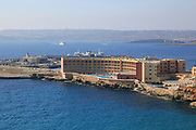 View of hotel and ferry terminal towards Gozo Channel, Cirkewwa, Republic of Malta