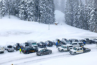 A parking SNAFU takes shape at the parking lot at the top of Teton Pass during a winter storm last April, the same day a snowboarder triggered a small slide at the base of Twin Slides that blocked both lanes of Highway 22 and closed the pass for most of the day.