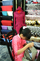 Hoi An is well known throughout Asia for its hand made crafts, particularly tailor made clothing.  Other specialties include silk lamps and lanterns and hard carved wooden items.