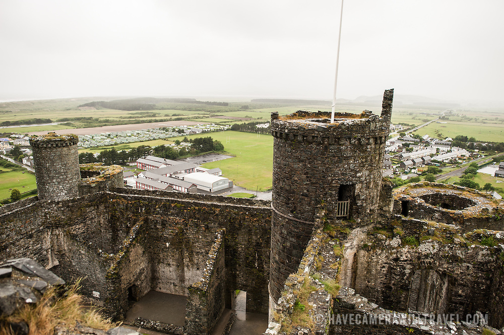 Towers and ramparts seen from above at Harlech Castle in Harlech, Gwynedd, on the northwest coast of Wales next to the Irish Sea. The castle was built by Edward I in the closing decades of the 13th century as one of several castles designed to consolidate his conquest of Wales.