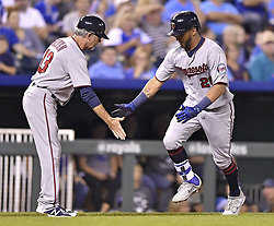 September 8, 2017 - Kansas City, MO, USA - The Minnesota Twins' Eddie Rosario is congratulated by third base coach Gene Glynn, left, after Rosario hit a solo home run in the third inning against the Kansas City Royals at Kauffman Stadium in Kansas City, Mo., on Friday, Sept. 8, 2017. (Credit Image: © John Sleezer/TNS via ZUMA Wire)