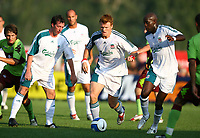 Fotball<br /> England 2005/2006<br /> Foto: PropagandaI/Digitalsport<br /> NORWAY ONLY<br /> <br /> ESCHEN, LICHTENSTEIN - SATURDAY, JULY 29th, 2006: Liverpool's Robbie Fowler, John Arne Riise and Djimi Traore in action against FC Kaiserslautern during a preseason match in Eschen