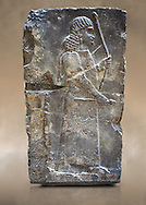 Stone relief sculptured panel of an archer. Inv AO 19885 from Dur Sharrukin the palace of Assyrian king Sargon II at Khorsabad, 713-706 BC.  Louvre Museum Room 4 , Paris .<br /> <br /> If you prefer to buy from our ALAMY PHOTO LIBRARY  Collection visit : https://www.alamy.com/portfolio/paul-williams-funkystock/ancient-assyria-antiquities.html  Refine search by adding background colour, place, subject, museum etc into the LOWER SEARCH WITHIN GALLERY box to <br /> <br /> Visit our ANCIENT WORLD PHOTO COLLECTIONS for more photos to download or buy as wall art prints https://funkystock.photoshelter.com/gallery-collection/Ancient-World-Art-Antiquities-Historic-Sites-Pictures-Images-of/C00006u26yqSkDOM