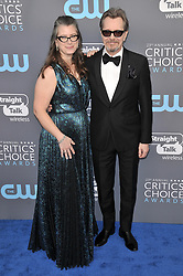Gisele Schmidt and Gary Oldman at The 23rd Annual Critics' Choice Awards held at the Barker Hangar on January 11, 2018 in Santa Monica, CA, USA (Photo by Sthanlee B. Mirador/Sipa USA)