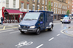 © Licensed to London News Pictures. 30/05/2013. London, UK. The police van carrying Michael Adebowale, one of two men charged with killing Drummer Lee Rigby in Woolwich last week, is seen arriving with an escort of armed police at Westminster Magistrates in London today (30/05/2013). Photo credit: Matt Cetti-Roberts/LNP