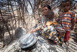 27 January 2019, Burka Dare IDP site, near Micha, Seweyna woreda, Bale Zone, Oromia, Ethiopia: Halima Ismael is one of many Oromo internally displaced people living in the Burka Dare IDP site. She regularly uses a simple kitchen to cook porridge. The Lutheran World Federation supports internally displaced people in several regions of Ethiopia, through emergency response on water, sanitation and hygiene (WASH) as well as long-term development and empowerment projects, to help build resilience and adapt communities' lifestyles to a changing climate.