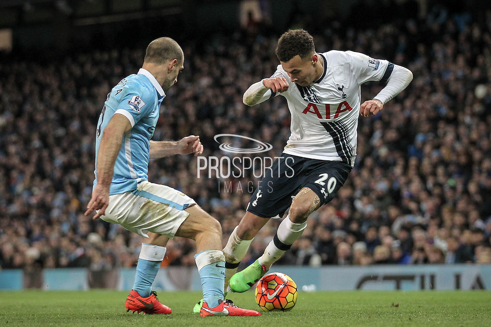 Dele Alli (Tottenham Hotspur) takes on Pablo Zabaleta (Manchester City) during the Barclays Premier League match between Manchester City and Tottenham Hotspur at the Etihad Stadium, Manchester, England on 14 February 2016. Photo by Mark P Doherty.