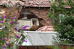 © Licensed to London News Pictures. 29/07/2011. Salford, UK. Childrens toys visible through the hole in the side of the house where a light aircraft has crashed, on Newlands Avenue, near Barton Aerodrome, in Salford, Greater Manchester. No one was killed. Photo credit : Joel Goodman/LNP