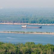 Barge going by podgory village in Volga near Samara