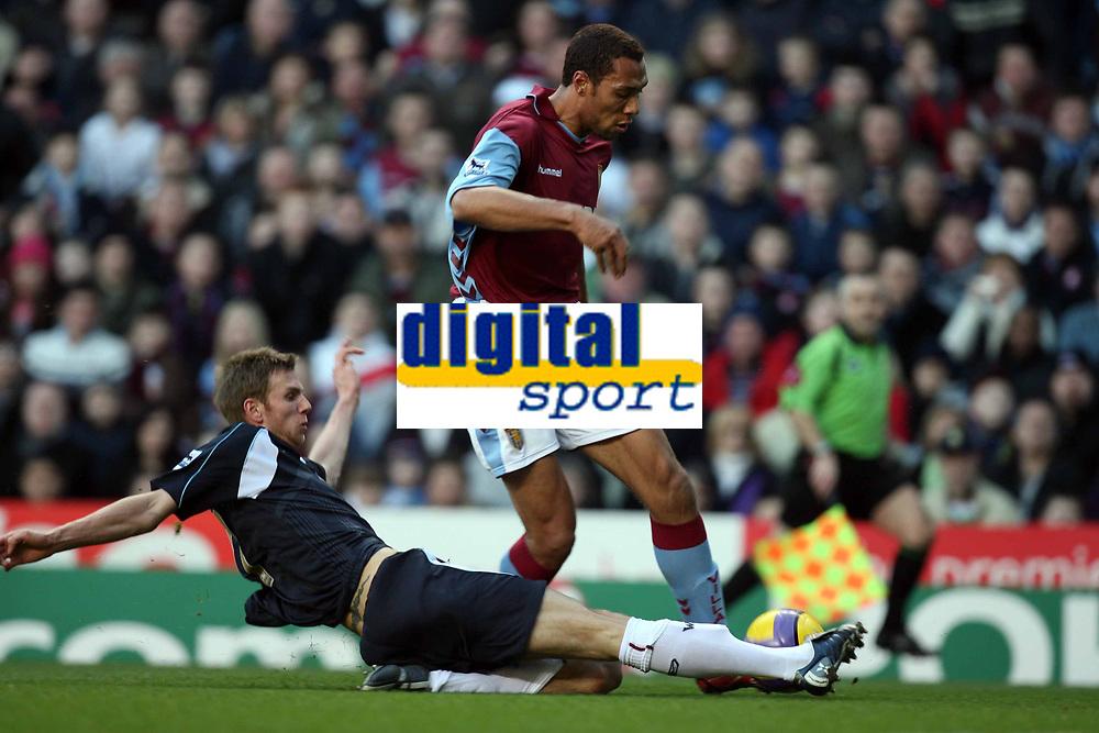 Photo: Rich Eaton.<br /> <br /> Aston Villa v West Ham. The Barclays Premiership. 03/02/2007. John Carew of Aston Villa right gets past Calum Davenport of West Ham