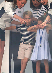 The Duke and Duchess of Cambridge take part in the inaugural regatta for The King's Cup to raise awareness and funds for eight of Their Royal Highnesses' patronages in Cowes, Isle of Wight, UK, on the 8th August 2019. Picture by Andy Matthews/WPA-Pool. 08 Aug 2019 Pictured: Catherine, Duchess of Cambridge, Kate Middleton, Prince George, Princess Charlotte. Photo credit: MEGA TheMegaAgency.com +1 888 505 6342