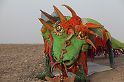 A colourful red and green statue of a dragon