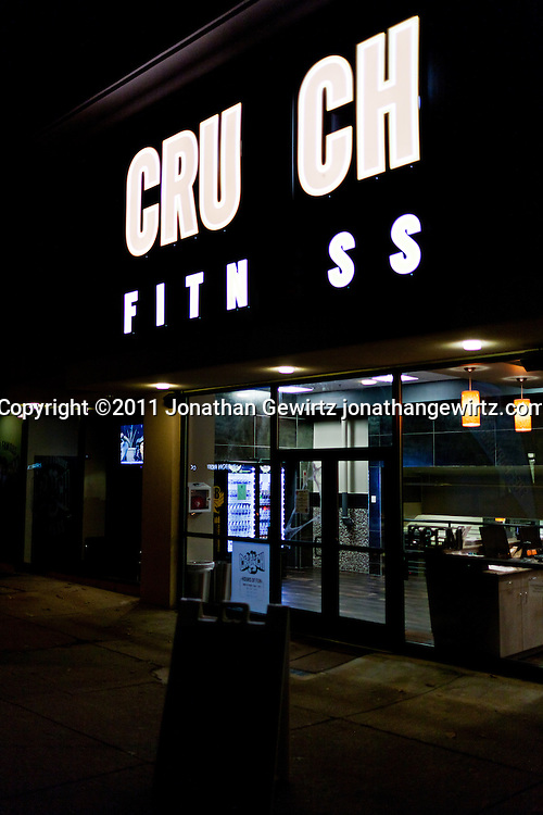 Crunch Fitness storefront with missing letters in illuminated sign. WATERMARKS WILL NOT APPEAR ON PRINTS OR LICENSED IMAGES.