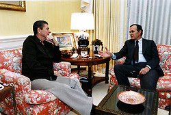 Washington, D.C. - October 26, 1983 -- United States President Ronald Reagan is briefed by Vice President George H.W. Bush in the White House Residence in Washington, DC immediately following the Vice President's return from Beirut, Lebanon on October 26, 1983. Photo by White House via CNP/ABACAPRESS.COM