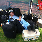 4/28/12 12:46:32 PM --- SPORTS SHOOTER ACADEMY IX --- ORANGE COUNTY, CA: Sports Shooter Academy co-founder Robert Hanashiro, finds a comfy spot to take a nap --- amid the workshop participants' Think Tank Photo rollers and cases before a sand volleyball shoot during Sports Shooter Academy IX.<br /> Photo by Deanna Hanashiro, Sports Shooter Academy Behind the Scenes with the cast and crew of Sports Shooter Academy.