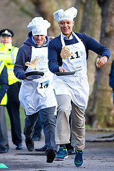 © Licensed to London News Pictures. 28/02/2017. London, UK. Conservative's JOHNNY MERCER MP and Labour's CLIVE LEWIS MP race against Lords and members of media at the annual Rehab Parliamentary Pancake Race outside the Parliament on Shrove Tuesday, 28 February 2017. Photo credit: Tolga Akmen/LNP