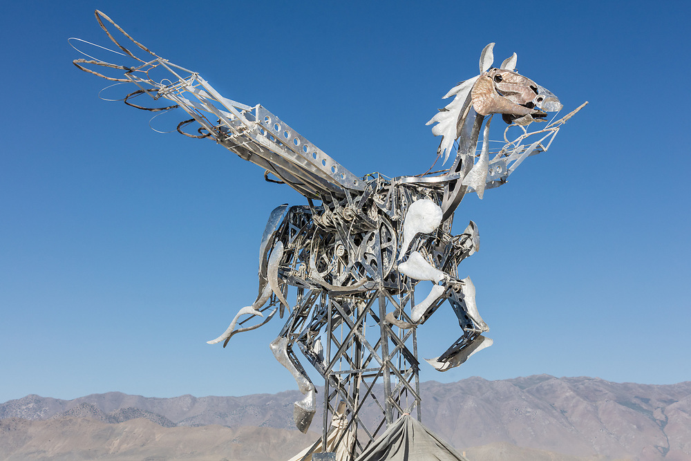 Wings of Glory by: Adrian Landon and the Dusty Sparks from: New York City, NY year: 2019<br /> <br /> Wings of Glory is a giant mechanical metal Pegasus sculpture, flying in the air. It is the expression and embodiment of pure, epic, beautiful and awesome creativity of New York based artist, Adrian Landon, and the forefront of his legacy of metal and kinetic art. URL: http://www.adrianlandon.com/adrianlandon.com/upcoming_projects.html Contact: adrianlandon@hotmail.com
