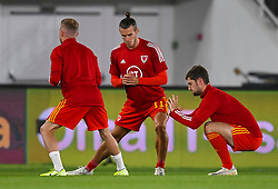 HELSINKI, FINLAND - Thursday, September 3, 2020: Wales' captain Gareth Bale (L) and Ben Davies during the pre-match warm-up before during the UEFA Nations League Group Stage League B Group 4 match between Finland and Wales at the Helsingin Olympiastadion. (Pic by Jussi Eskola/Propaganda)