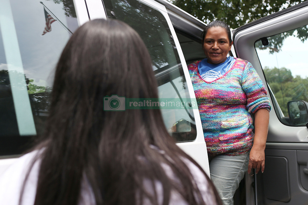 July 26, 2018 - San Antonio, Texas, U.S. - SANDRA ELIZABETH SANCHEZ, 44, turns to look at her daughter, CRISTHEL NOHELIA BARAHONA SANCHEZ, 15, as they board a van leaving the Archdiocese of San Antonio Catholic Charities offices, Thursday. Sanchez and her daughter were caught by U.S. Border Patrol in Eagle Pass on June 18 and separated. Sanchez reunited with her daughter Wednesday night after they were released and are headed to Washington State where her older daughter and three grandchildren live. (Credit Image: © Jerry Lara/San Antonio Express-News via ZUMA Wire)
