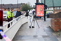 South Yorksire Police Crime Scene Investigator photographs the area on Halifax Road stretching from Kilner way to Southey Green Rd. Locals information say the crime was a stabbing.<br /> <br /> 29 October 2015<br />  Image © Paul David Drabble <br />  www.pauldaviddrabble.co.uk