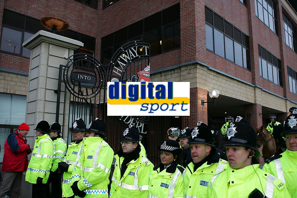 Photo: Andrew Unwin.<br />Sunderland v Wigan Athletic. The Barclays Premiership. 11/03/2006.<br />A line of police block the gates at the Stadium of Light as fans protest after the game.