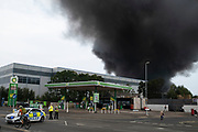 Massive scale fire at a plastics factory at Tyseley Industrial Estate on 10th August 2020 in Birmingham, United Kingdom. The blaze, which could be seen from miles away sent a vast and harmful plume of black smoke up into the air near residential homes and businesses in the area.  Roads were blocked off to all traffic as some 100 members of the fire service tackled the difficult fire.