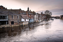 © Licensed to London News Pictures. 12/03/2021. York UK. The River Ouse in York city centre has broken its banks this morning flooding riverside footpaths & property after heavy rainfall. Photo credit: Andrew McCaren/LNP