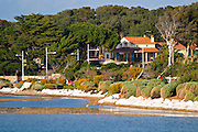 The main building and garden. Seen from across the bay Clos des Iles Chambres d'Hotes Bed and Breakfast Le Brusc Six Fours Cote d'Azur Var France