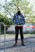 outdoors food market shopper with improvised mask during Covid 19 crisis France Limoux April 2020