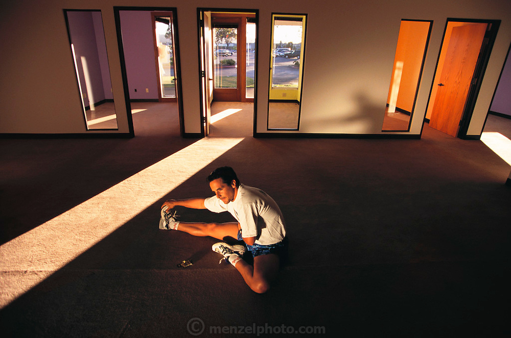 Silicon Valley, California; Start-up ASIMBA.com; New office. Scott Hublou, CEO; Stretches before am evening run 7:40 pm. Model Released (1999).