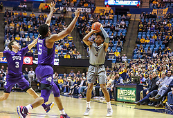 Jan 14, 2020; Morgantown, West Virginia, USA; West Virginia Mountaineers guard Miles McBride (4) shoots over TCU Horned Frogs guard Jaire Grayer (5) during the second half at WVU Coliseum. Mandatory Credit: Ben Queen-USA TODAY Sports