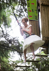Colette Gregory after tying the knot in the trees at Go Ape Aberfoyle, heading to a zip wire to the climbing net.