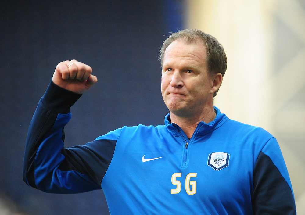 Preston North End manager Simon Grayson celebrates his sides second half come back, which saw them win 3-2, after being two down at half time<br /> <br /> Photographer Chris Vaughan/CameraSport<br /> <br /> Football - The Football League Sky Bet League One - Preston North End v Fleetwood Town - Saturday 25th October 2014 - Deepdale - Preston<br /> <br /> © CameraSport - 43 Linden Ave. Countesthorpe. Leicester. England. LE8 5PG - Tel: +44 (0) 116 277 4147 - admin@camerasport.com - www.camerasport.com