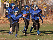 Middletown, New York - Middletown players celebrate at the end of a victory over Port Jervis in an Orange County Youth Football League Division II semifinal playoff game at Watts Park on  Nov. 15, 2014.