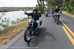Riding through Tomoka State Park during Daytona Bike Week 75th Anniversary event. FL, USA. Thursday March 3, 2016.  Photography ©2016 Michael Lichter.