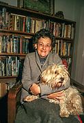 Elizabeth Hawley with her dog Mallory in her home in Kathmandu, Nepal