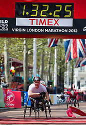 © London News Pictures. 22/04/2012. London, UK. Britain's David Weir crosses the finish line to win his fifth London Marathon wheelchair race at the 2012 Virgin London Marathon on April 22, 2012. Photo credit : Ben Cawthra /LNP