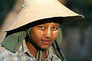 A young woman is photographed in Myanmar (Burma).