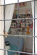 Looking in to a cell through the barred window. HMP Styal, Wilmslow, Cheshire