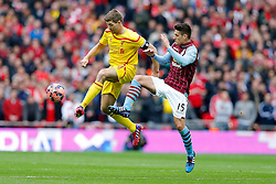 Steven Gerrard of Liverpool is challenged by Ashley Westwood of Aston Villa - Photo mandatory by-line: Rogan Thomson/JMP - 07966 386802 - 19/04/2015 - SPORT - FOOTBALL - London, England - Wembley Stadium - Aston Villa v Liverpool - FA Cup Semi Final.